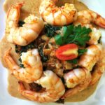 Shrimps with dried tomatoes and spinach